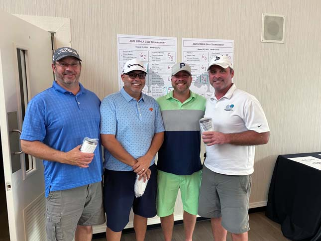 Some of the foursome team winners.